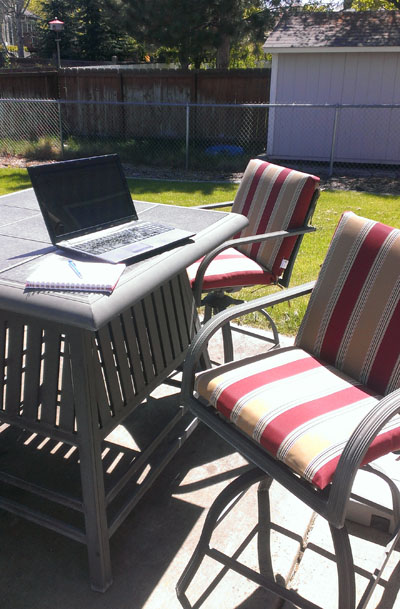 Laptop on patio table